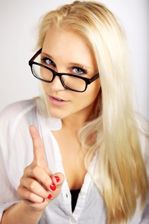 Female business executive  pointing her finger up and warning and giving you an advice photo