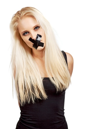 silenced: Voiceless woman with a duct tape over her mouth in a struggle for her freedom of expression