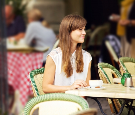 outdoor cafe: Beautiful woman sitting in an outdoor cafe on a summer day