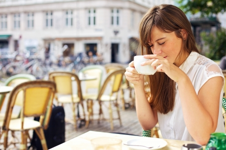 coffees: Woman enjoying the beautiful morning outdoors and smelling the coffees aroma