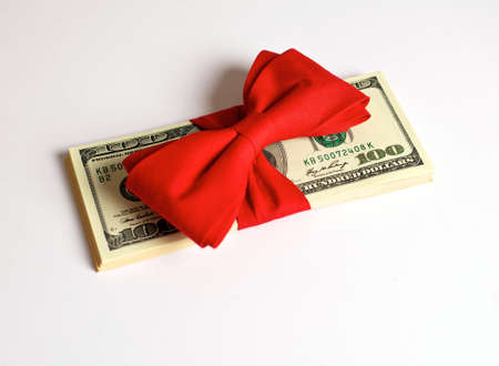bribe: American dollars with a red ribbon