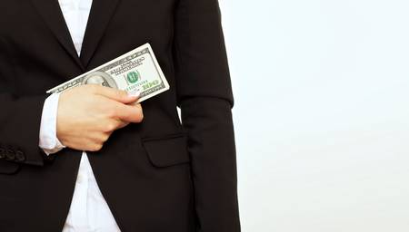 american banker: Businessperson in black suit holding a dollar bill isolated on white