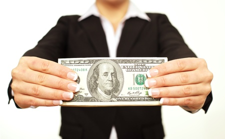 Businessperson holding a hundred dollar bill Stock Photo - 17353392
