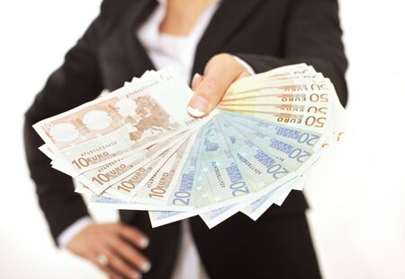 Business person in black suit paying in Euros as a bribe photo