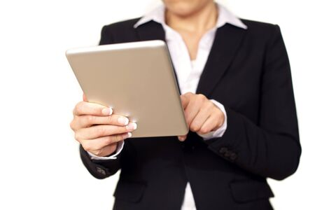 Young business woman in black suit using a digital tablet. Isolated on white background. photo