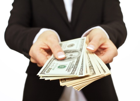 bribe: Business executive in formal suit giving money as a bribe