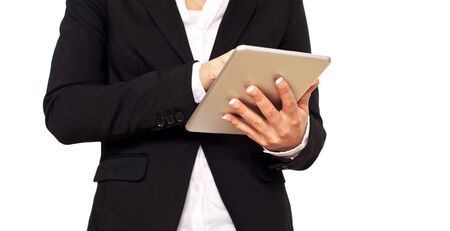Woman in black suit using a digital tablet  photo