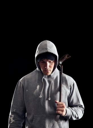 Dangerous guy with a crowbar in the dark photo