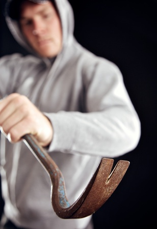 felony: Intruder uses a crowbar in breaking into your home