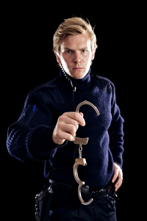 Law enforcer holding handcuffs and about to arrest you Stock Photo - 17724733
