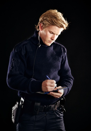 law enforcer: Policeman in uniform writing you a fine Stock Photo