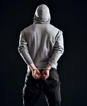 delito: El hombre detenido como consecuencia de su crimen Foto de archivo