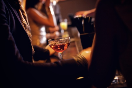 social event: Party people with sparkling red wine on focus