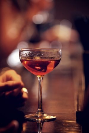 bar: Glass of sparkling red wine on the bars counter Stock Photo