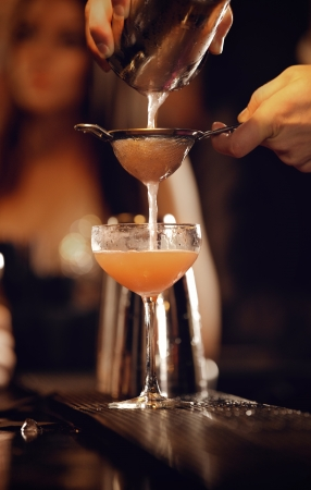 bartending: Bartender working at a nightclub pouring wine