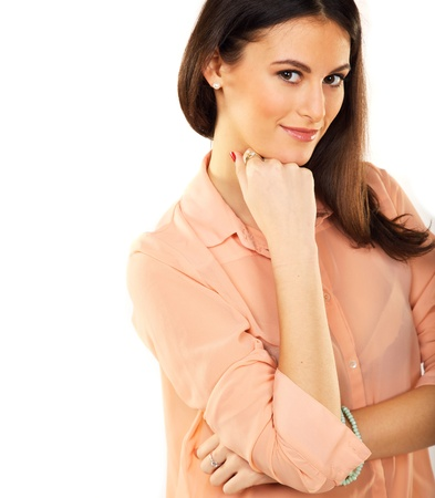 Closeup of a confident woman with hand on chin isolated on white background Stock Photo - 18816246