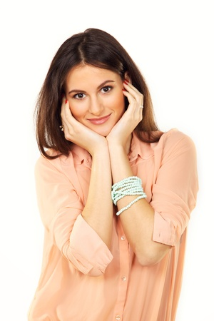 Charming and joyful woman with pearl bracelet posing in a studio photo