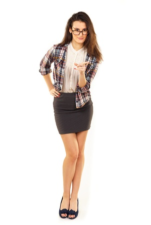 sexy teacher: Portrait of a beautiful but strict teacher pointing at you isolated on white