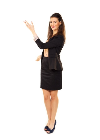 sales executive: Young businesswoman hand gesturing in copyspace