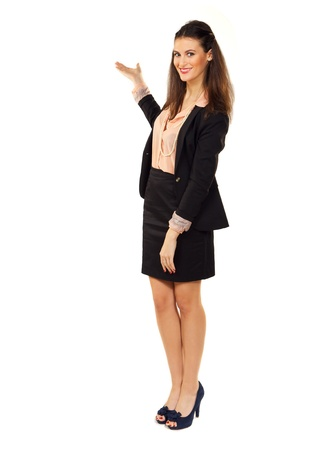 promoter: Portrait of an attractive manager standing in a studio showing copyspace Stock Photo