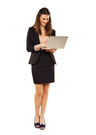 Corporate woman against white background using laptop Stock Photo - 19122164