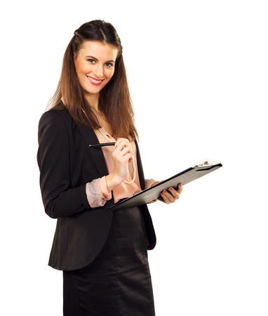 Satisfied female executive holding a clipboard photo
