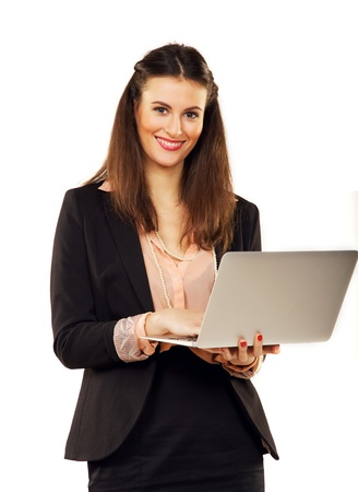Smiling confident businesswoman in a studio browsing the internet photo