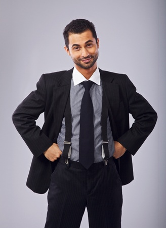 hands on waist: Happy businessman with hands on his waist looking at you Stock Photo