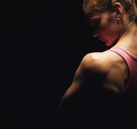 Closeup of a fitness woman's shoulders photo