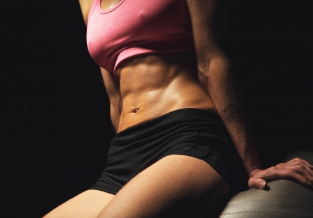 abdominal: Closeup of a fitness womans toned abs