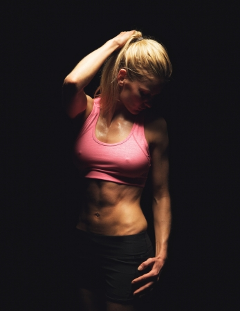 Portrait of a fitness woman posing in studio photo