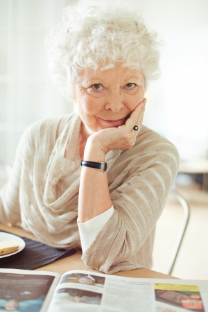Portrait of a senior woman looking at you with hand on chin Stock Photo - 20899358