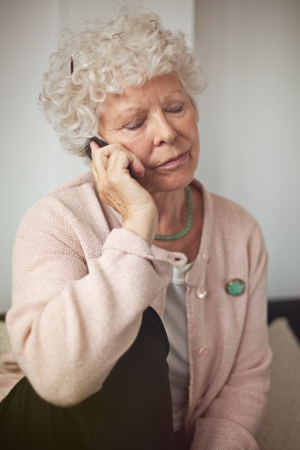 Grandmother using a cell phone in communicating Stock Photo - 20899418