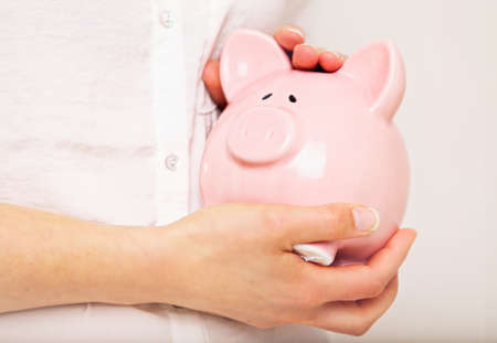 Woman taking good care of her money and savings Stock Photo - 20899437