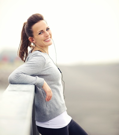 Smiling woman having her break after running photo