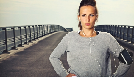 Serious female jogger outdoors looking confident Stock Photo