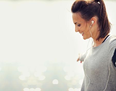 elated: Closeup of a female runner smiling
