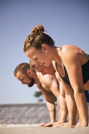 push up: Muscular active people in 20s training to maintain healthy lifestyle. Stock Photo