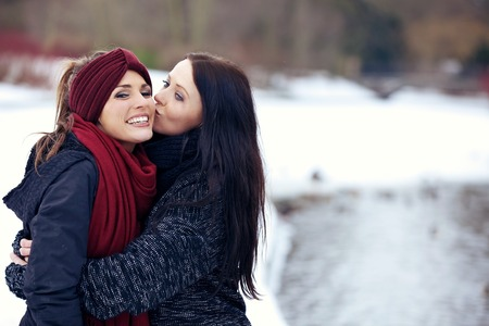 homosexual couple: Happy Friends in Snowy Park  Winter season  Stock Photo