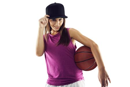 Beautiful and sporty woman holding basket ball against white . Young caucasian female with basketball player. photo