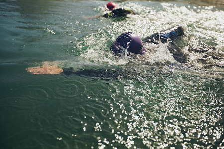 long distance: Athletes swimming in a competition. Open water swimming, athletes swimming long distance.
