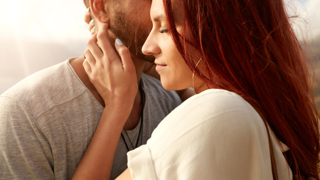 romantic couples: Close up shot of beautiful young woman with her boyfriend. Young couple together outdoors. Stock Photo