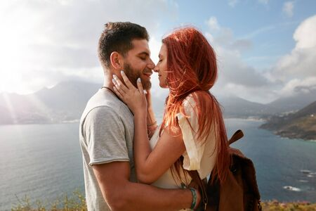 couple nature: Portrait of young man and woman about to share a romantic kiss. Affectionate young couple enjoying their love in nature outdoors on a sunny day. Stock Photo