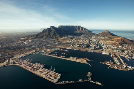 commercial docks: Aerial view of entrance of the port of cape town. Commercial docks of cape town harbour. Stock Photo