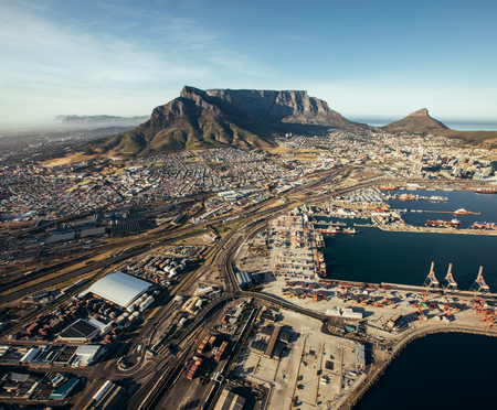 town: Aerial view of cape town harbor. Commercial docks and shipping yards. Stock Photo
