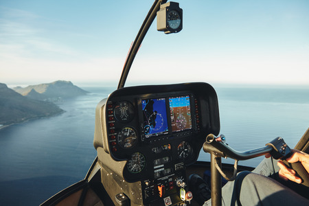 Instruments panel of a helicopter cockpit flying over the sea. Interior of helicopter control dashboard