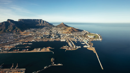 seaside town: Aerial view of Victoria & Alfred Waterfront and Cape Town Harbour. Commercial docks and jetty on the sea.