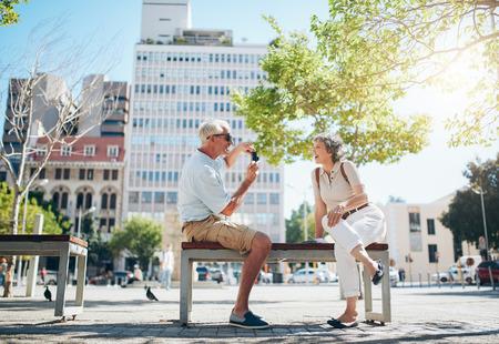 Senior man taking photos of his woman. Mature couple having fun on their holiday. Stock Photo