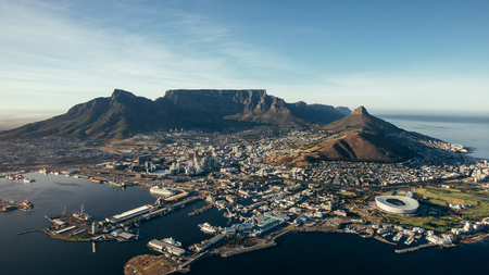 Aerial coastal view of cape town city with table mountain, cape town harbour, lions head and devils peak, South africa.