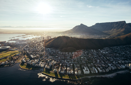Birds eye view of city of cape town with buildings on water front on a bright sunny day. Aerial view of Cape Town city.